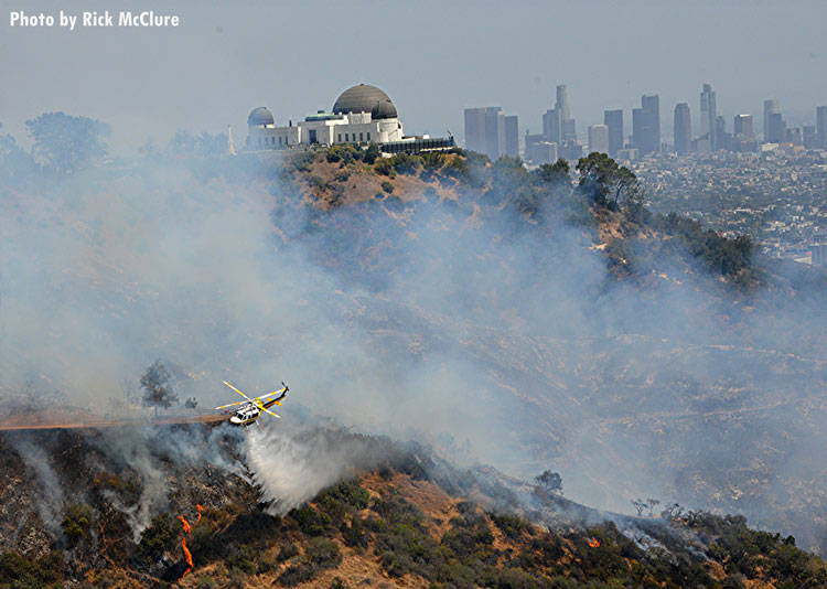 Griffith Park brush fire with city of Los Angeles in the background