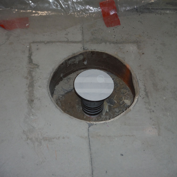 The opening that has been provided around a floor drain in a concrete floor