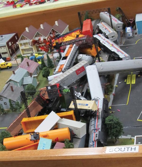 A closeup of a passenger vehicle/freight train derailment accident.