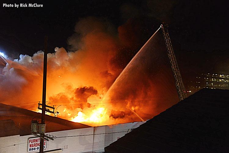 Fire streams training on burning building