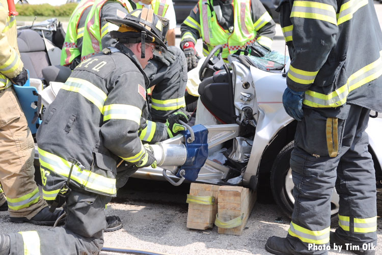 Firefighters perform extrication operations on a pin job in Illinois