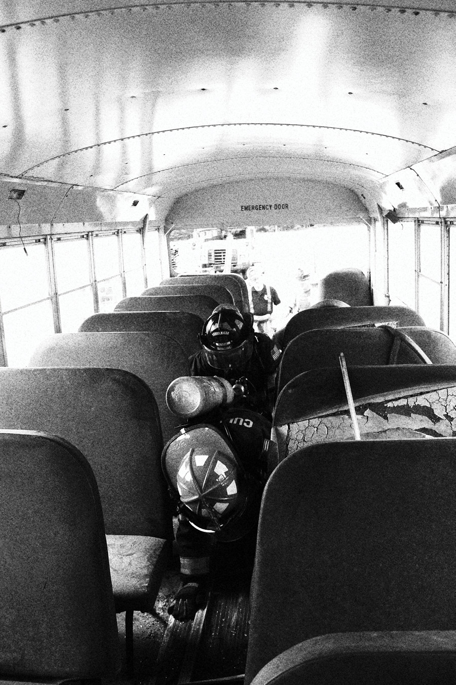 These firefighters are participating in a Brothers of the Boot F.O.O.L.S. training event in which they practiced making rescues from a bus under realistic conditions and in full personal protective equipment and self-contained breathing apparatus.