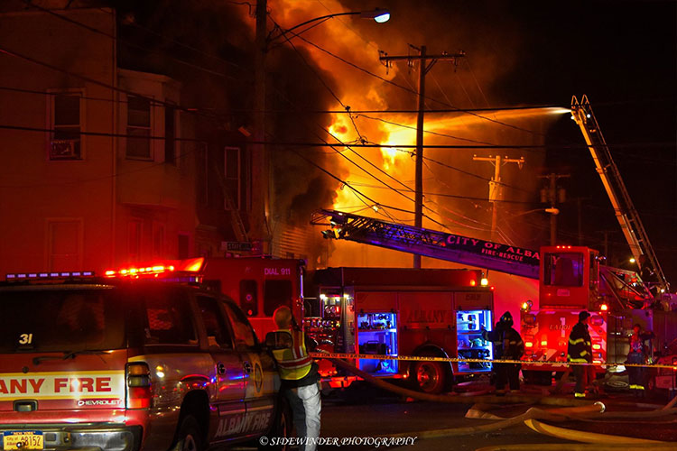 Fire in a row house with fire apparatus