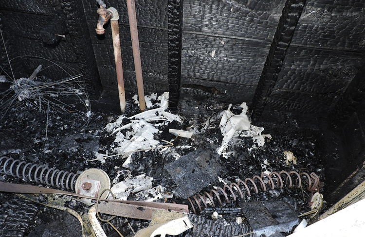 The point of origin before the area was cleared. The white material is the remains of the ladder, which is mixed in with the white plastic from the lawn chairs (Photos by author.)