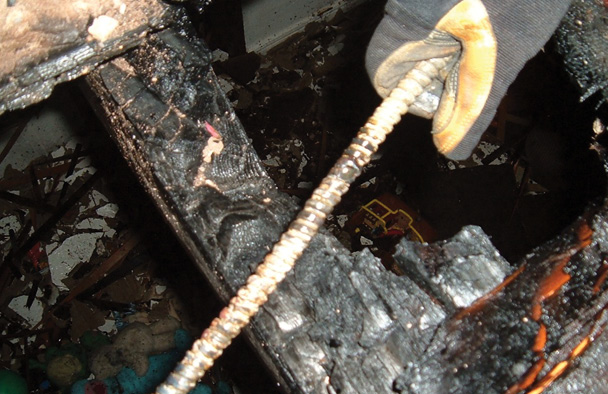 The investigator found this between the floor and the ceiling. Note the black area, indicating a blowout.