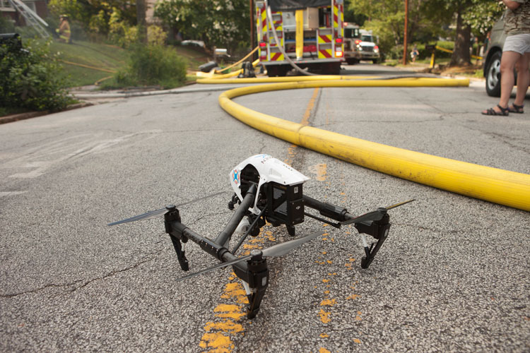 Drone and fire hose