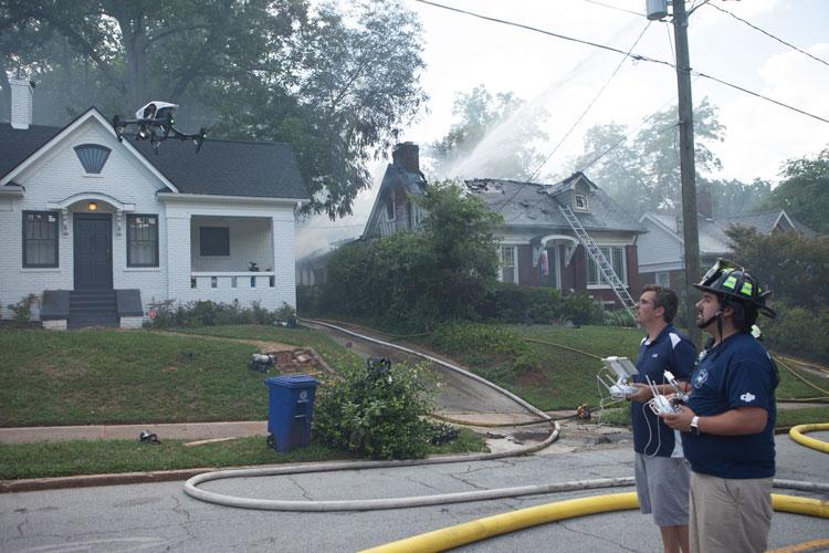 Man in fire helmet pilots drone
