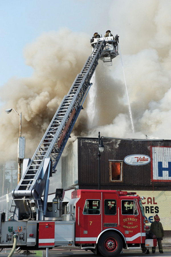 When the roof is sagging or ready to collapse, tower ladders should operate above it so that the walls don't fall onto the bucket and for overall safety. (Photo by J.J. Cassetta.)