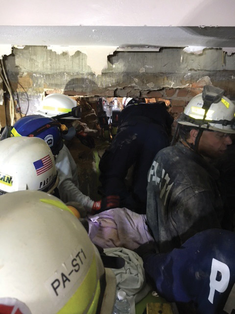 After the secondary collapse, a rescuer aided by crews accessed the victim through the B-side exposure. (Photo by Joseph Janosko.)