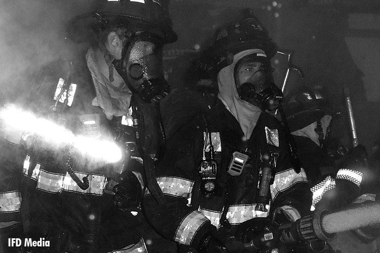 Firefighters operate a hoseline