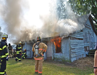 Live burn instructors monitor conditions