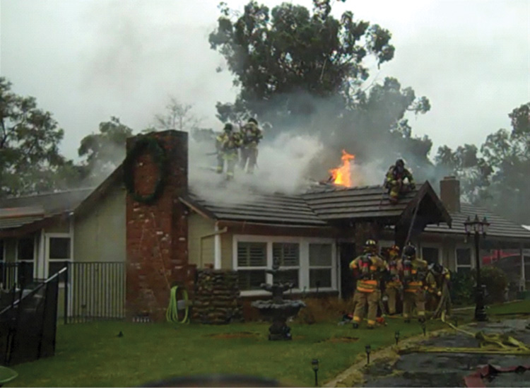 By the time fire was visible, Division A was established. Note the crews on the A side. The Division A supervisor was there at the front door, coordinating face-to-face with crews inside, on the roof, and approaching. The fresh crews had to check in with Division A prior to entry with an assignment. The radio traffic was minimal.