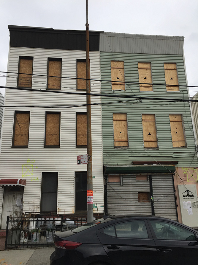 (1) Two vacant adjacent row-frame houses/buildings. The structure on the right has HUD windows and door and window guard systems (DAWGS). (Photos by author.)