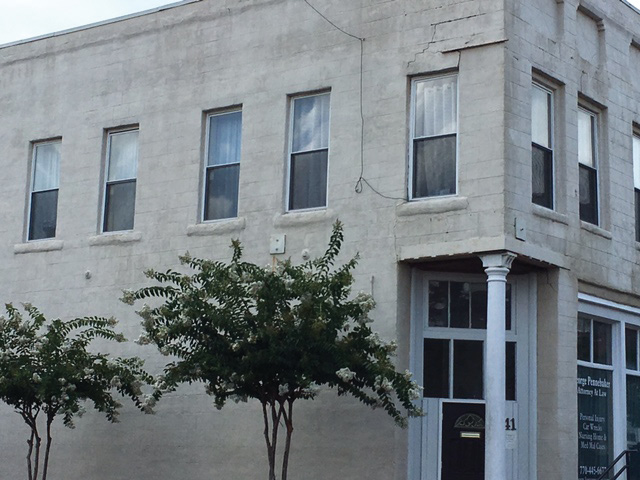 A commercial occupancy with structural damage and reinforcing ties.
