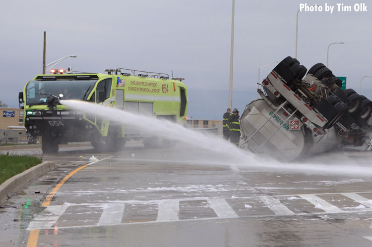 Chicago Fire Department vehicle pours foam on rolled over vehicle