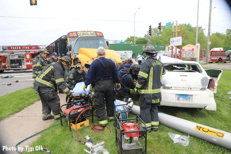 Firefighters work to free a person trapped in a crushed car