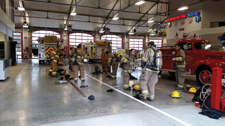 Recruits drill on donning personal protective equipment, first for accuracy, then for time.
