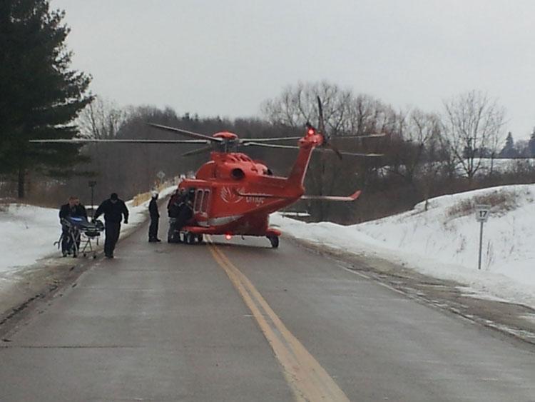 Crew members escort responders to helicopter