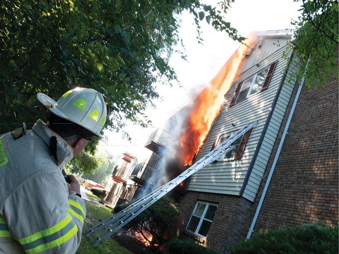 Diamond Street: The Lawrence Task Force chief radios command, citing conditions from the rear of the building.