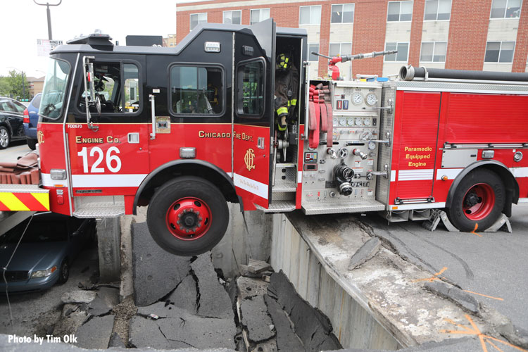 Chicago fire truck nearly falls into hole