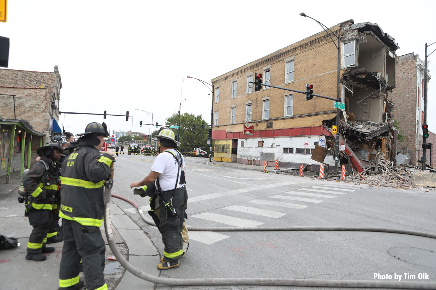 Chicago fire members assess the situation.