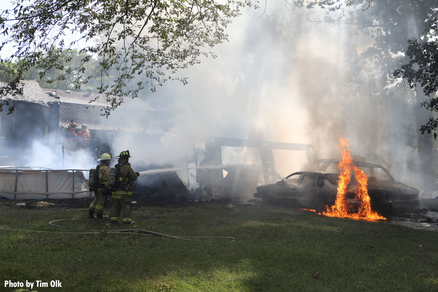 Firefighters confront flames at the scene of the fire.