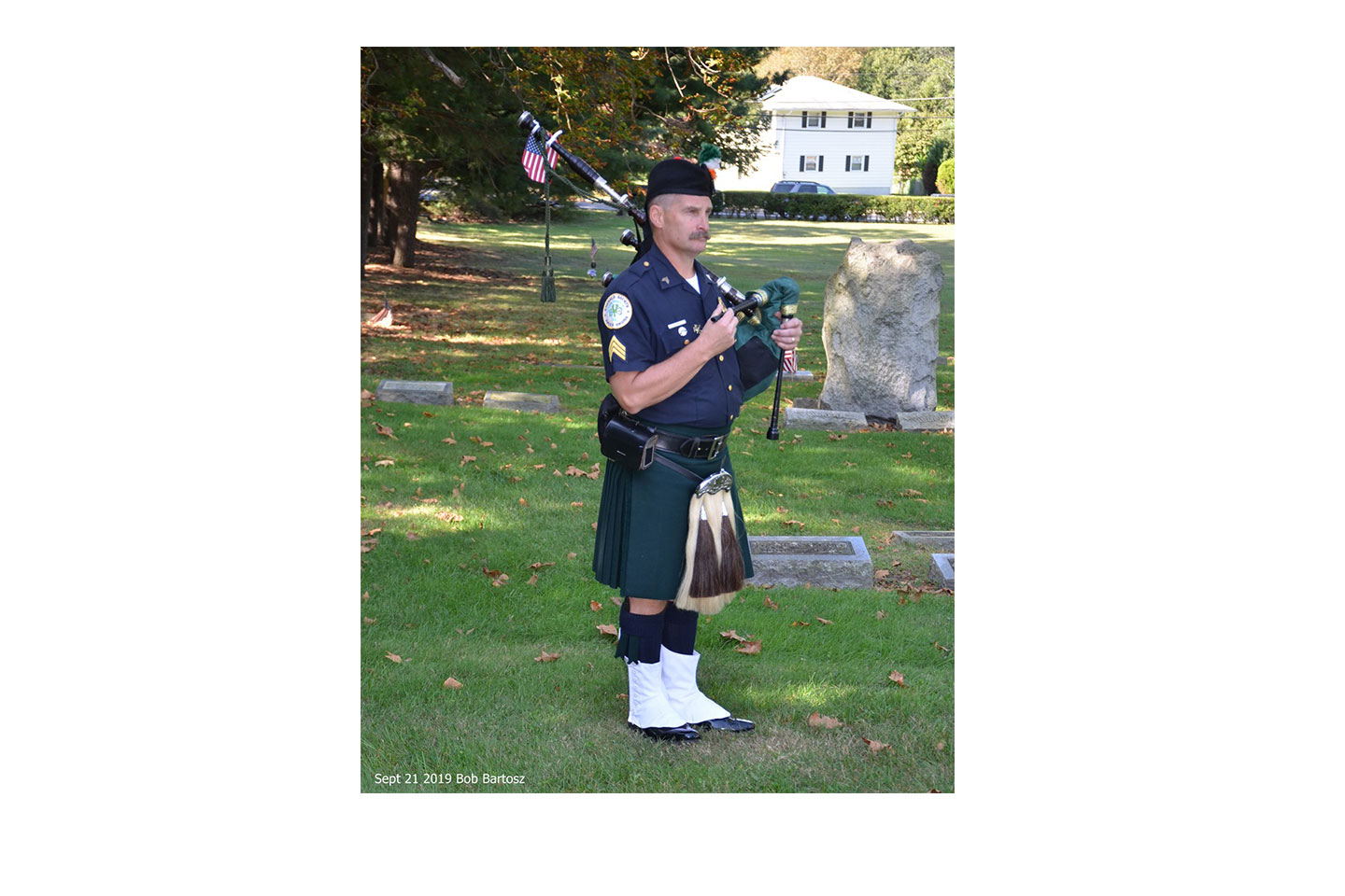 A piper at the scene of the recent Camden memorial service.