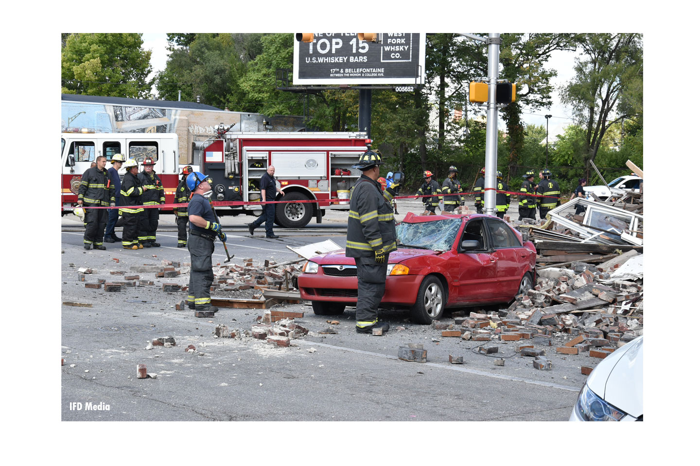 Indy firefighters at the scene of the collapse and collision.