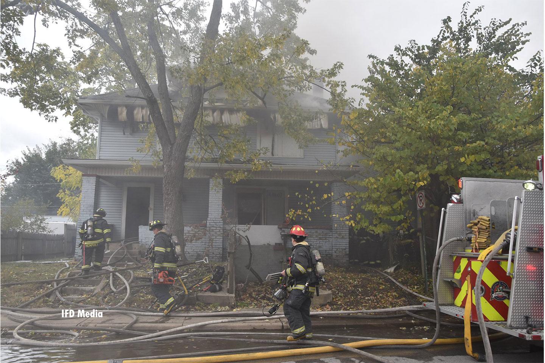 Fire crews advance lines on scene.