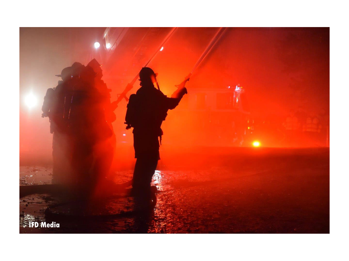 Firefighters operating hoselines