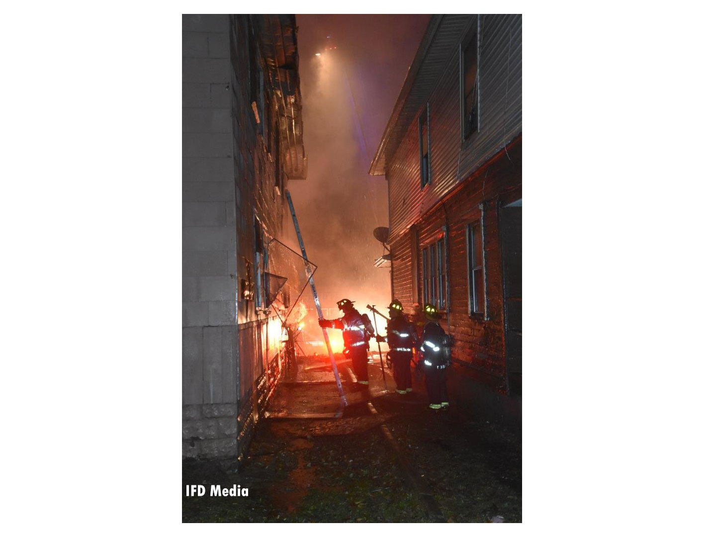 Firefighters set up a ground ladder