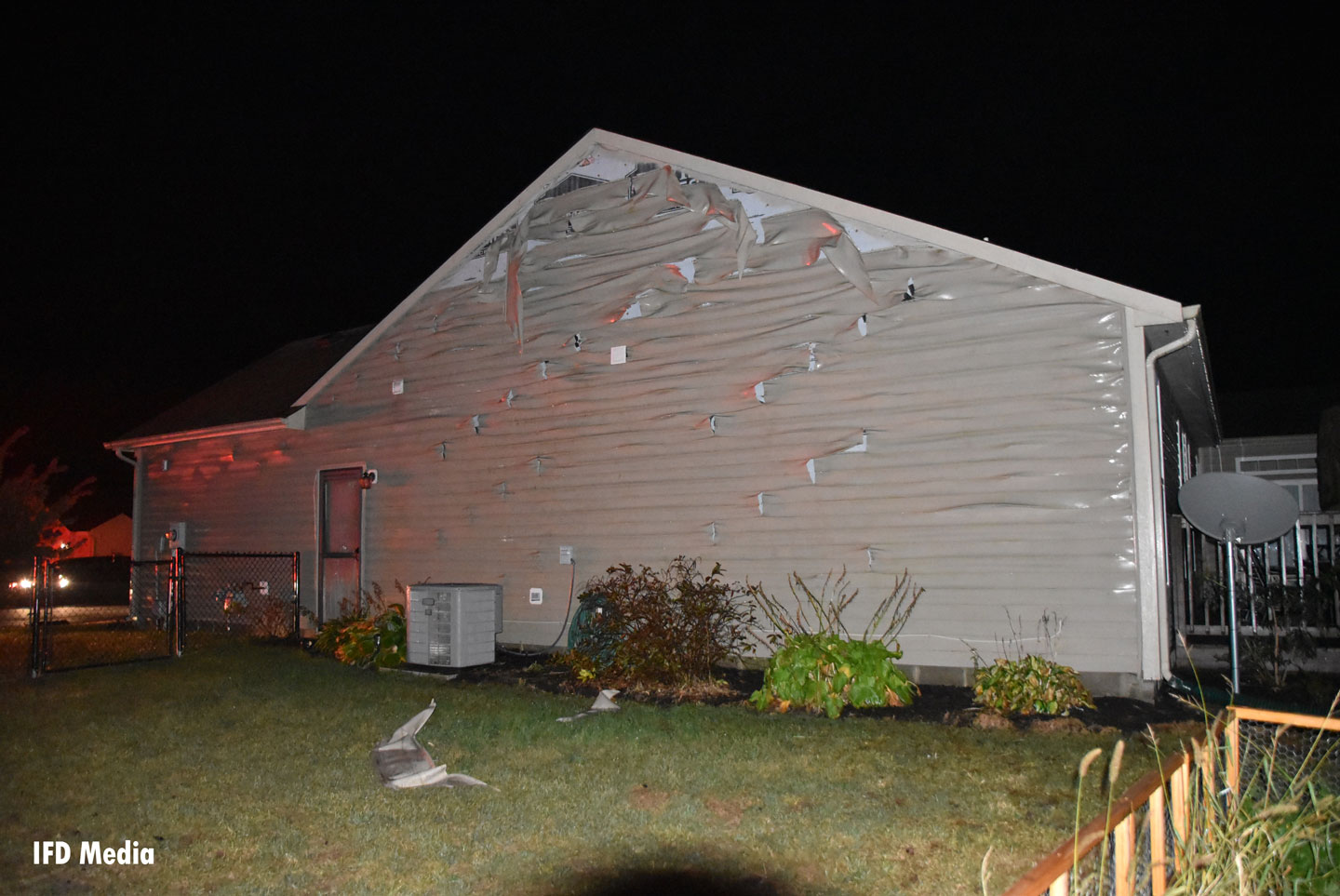 Melted siding on one home.