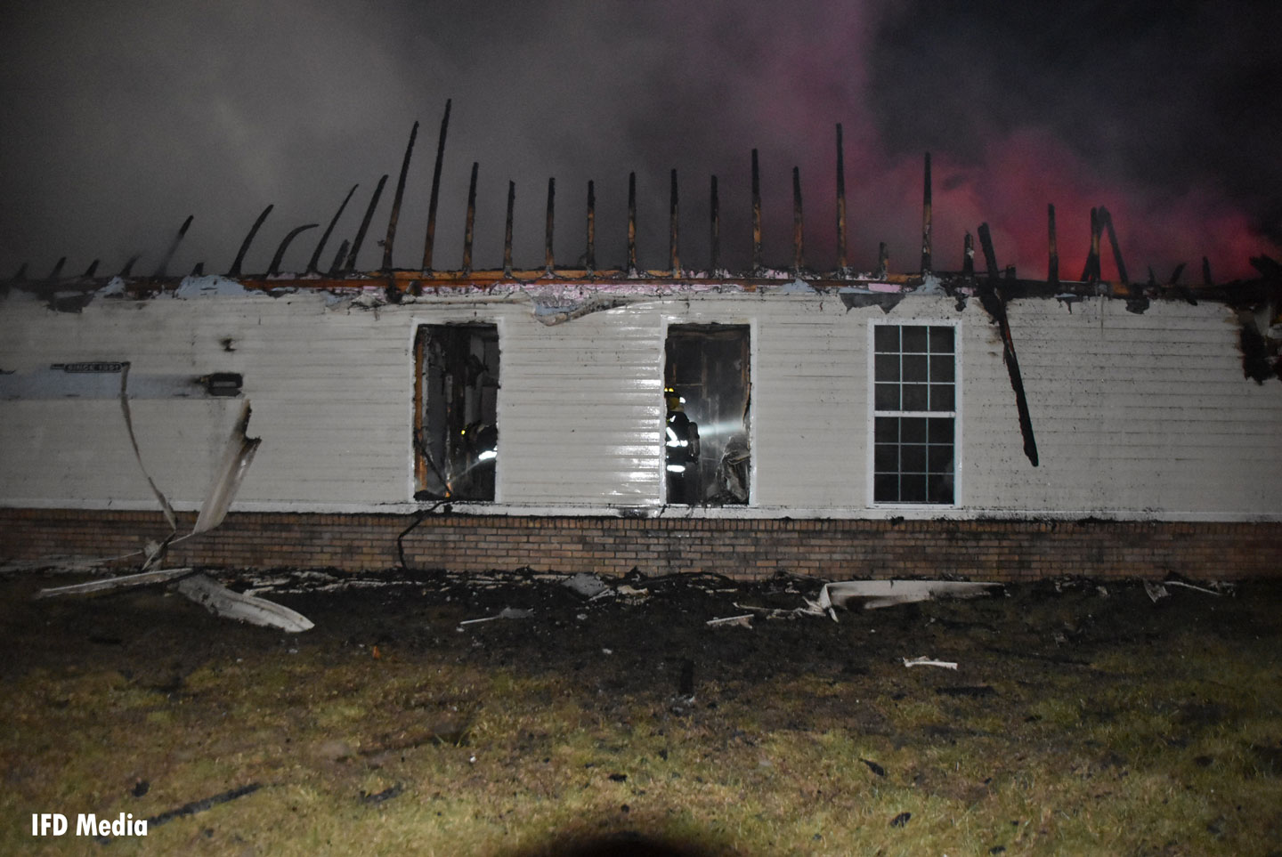 Fire damage to another of the homes.