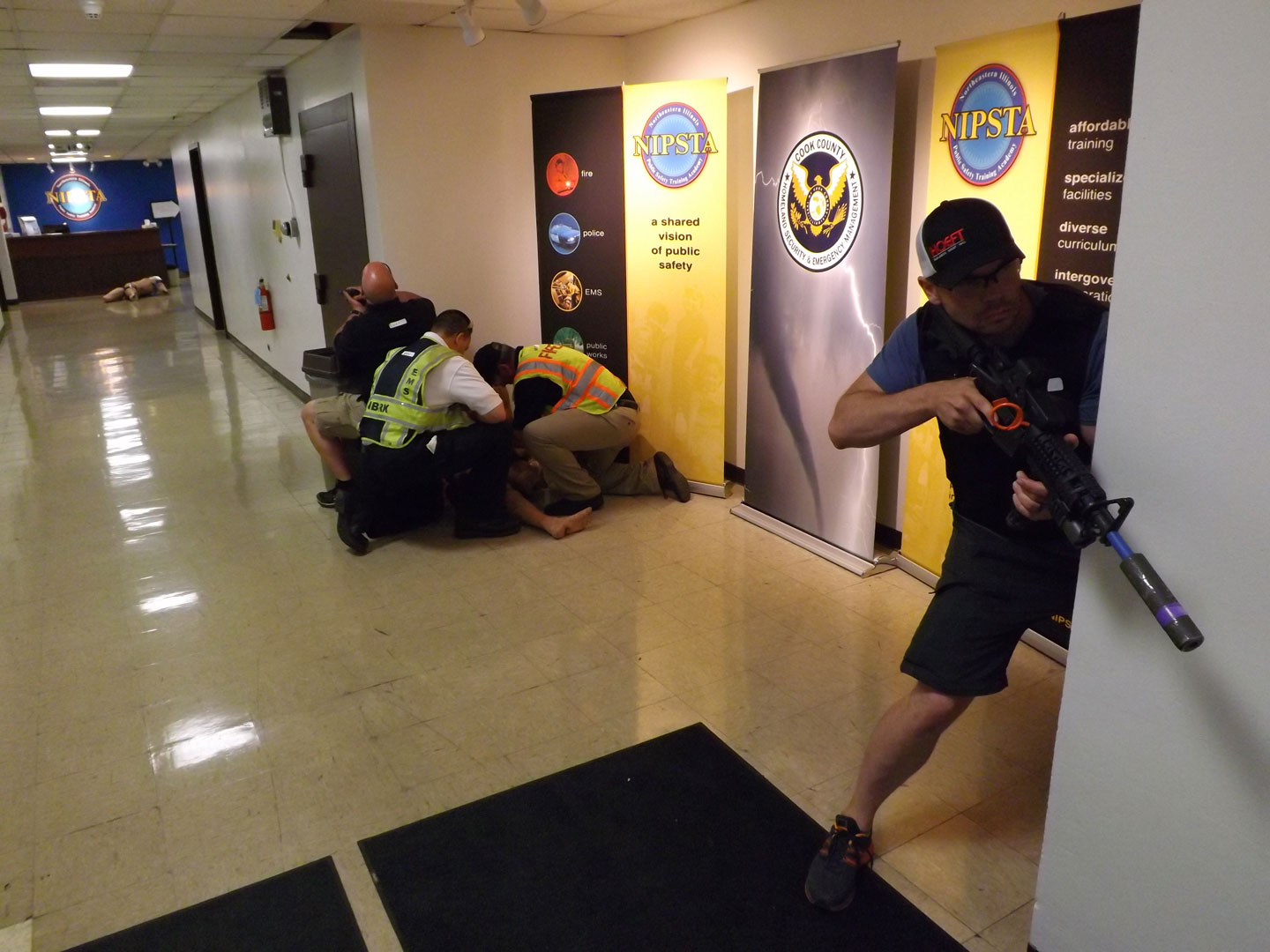 Law enforcement establishes a protected corridor for responders to assist patients.