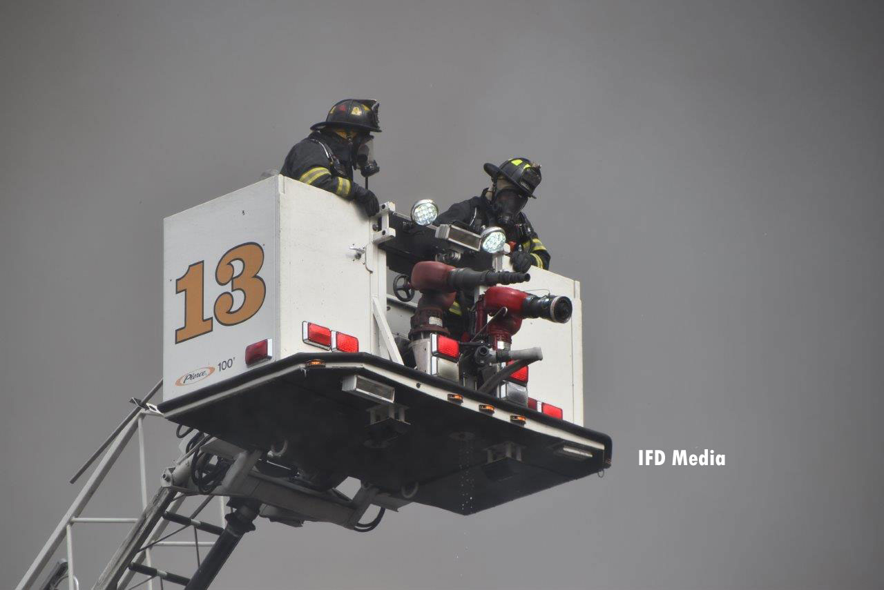 Firefighters in a tower ladder bucket