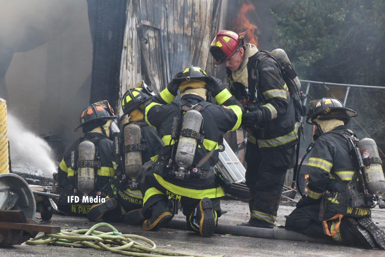 Firefighters working at the scene of a warehouse fire in Indianapolis, Indiana.