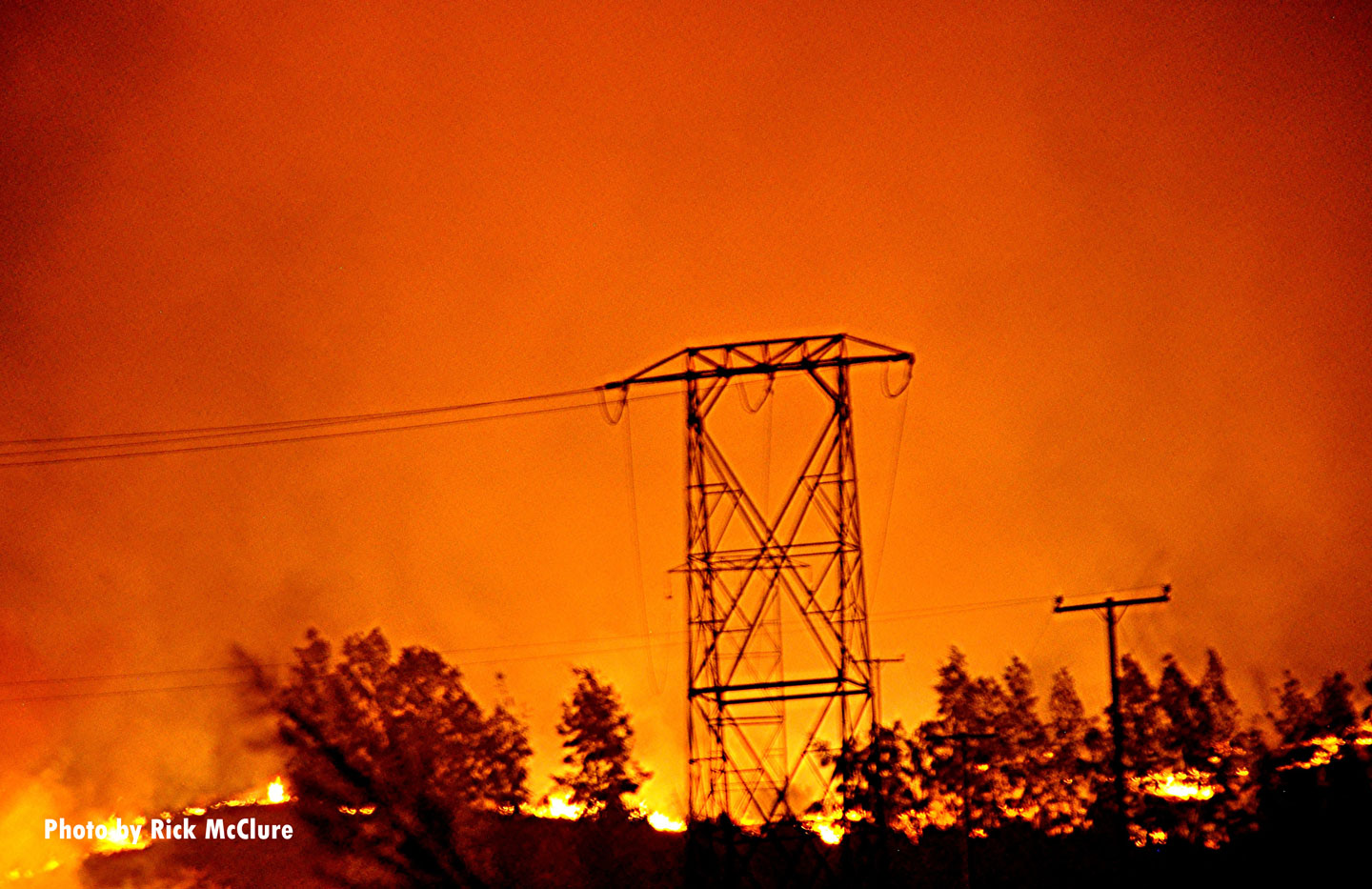 A view of power lines framed by flames of the Maria Fire in Southern California.