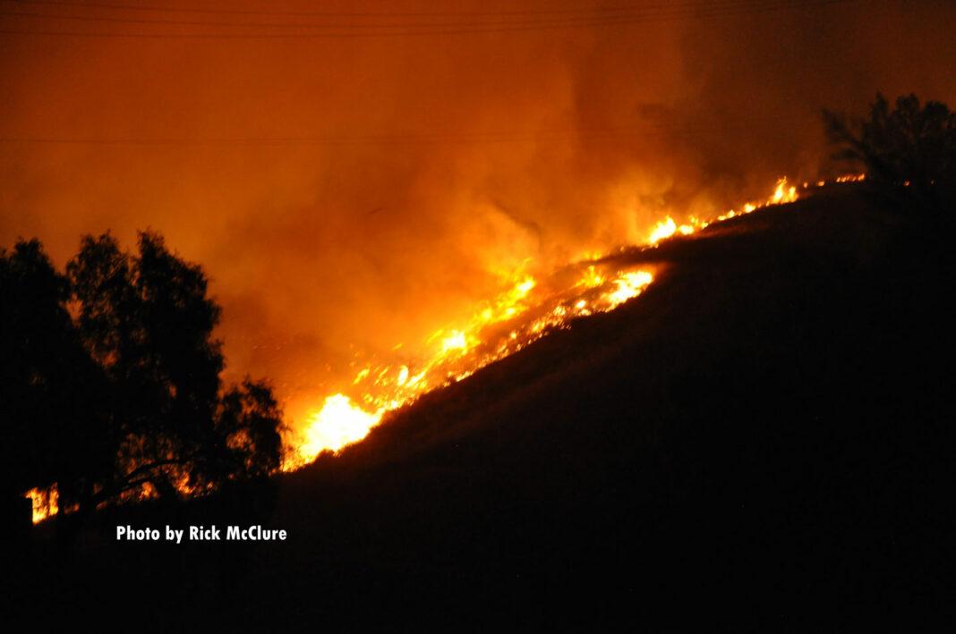 Fire tears down a hillside in Southern California