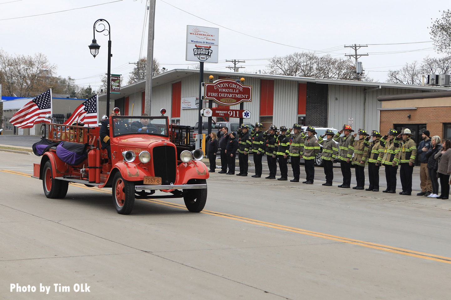 Old fire apparatus makes its way down the route during the funeral