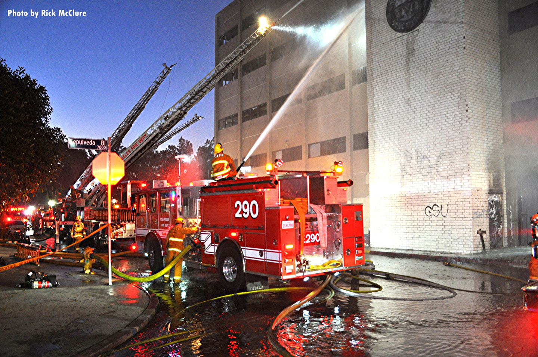 LAFD fire trucks and streams on scene.