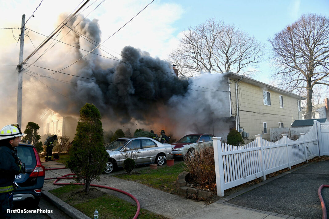 Smoke and fire at a house fire in the community of Lakeview.