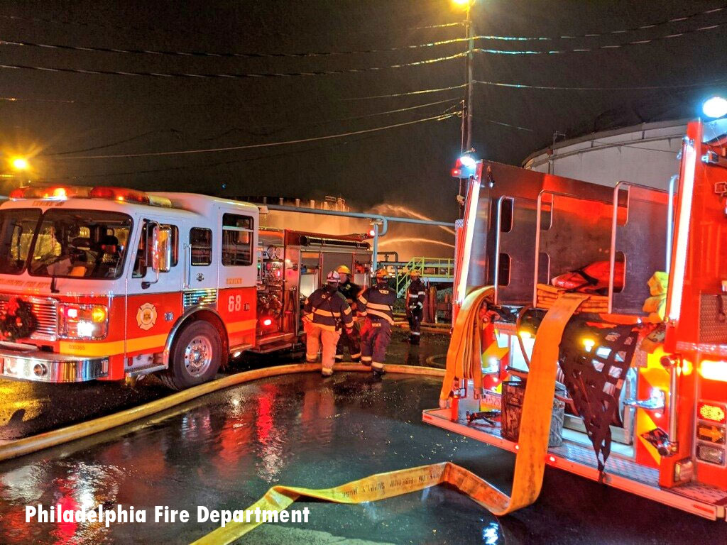 Philadelphia Fire Department rigs at fuel facility fire