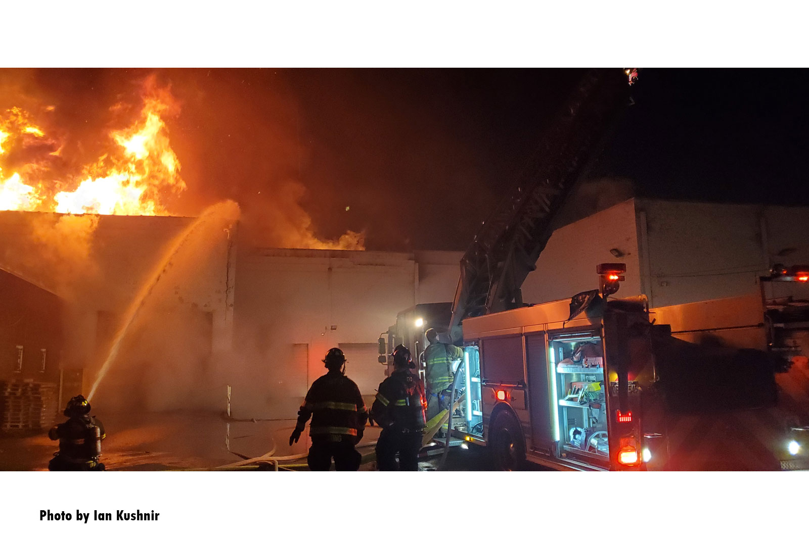 Firefighters at the scene of a massive fire in Dearborn, Michigan.