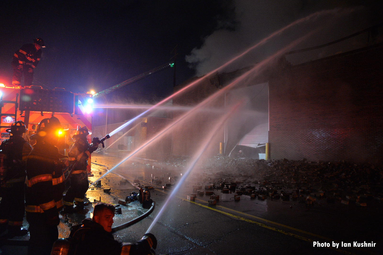 Multiple hose streams in use at the fire