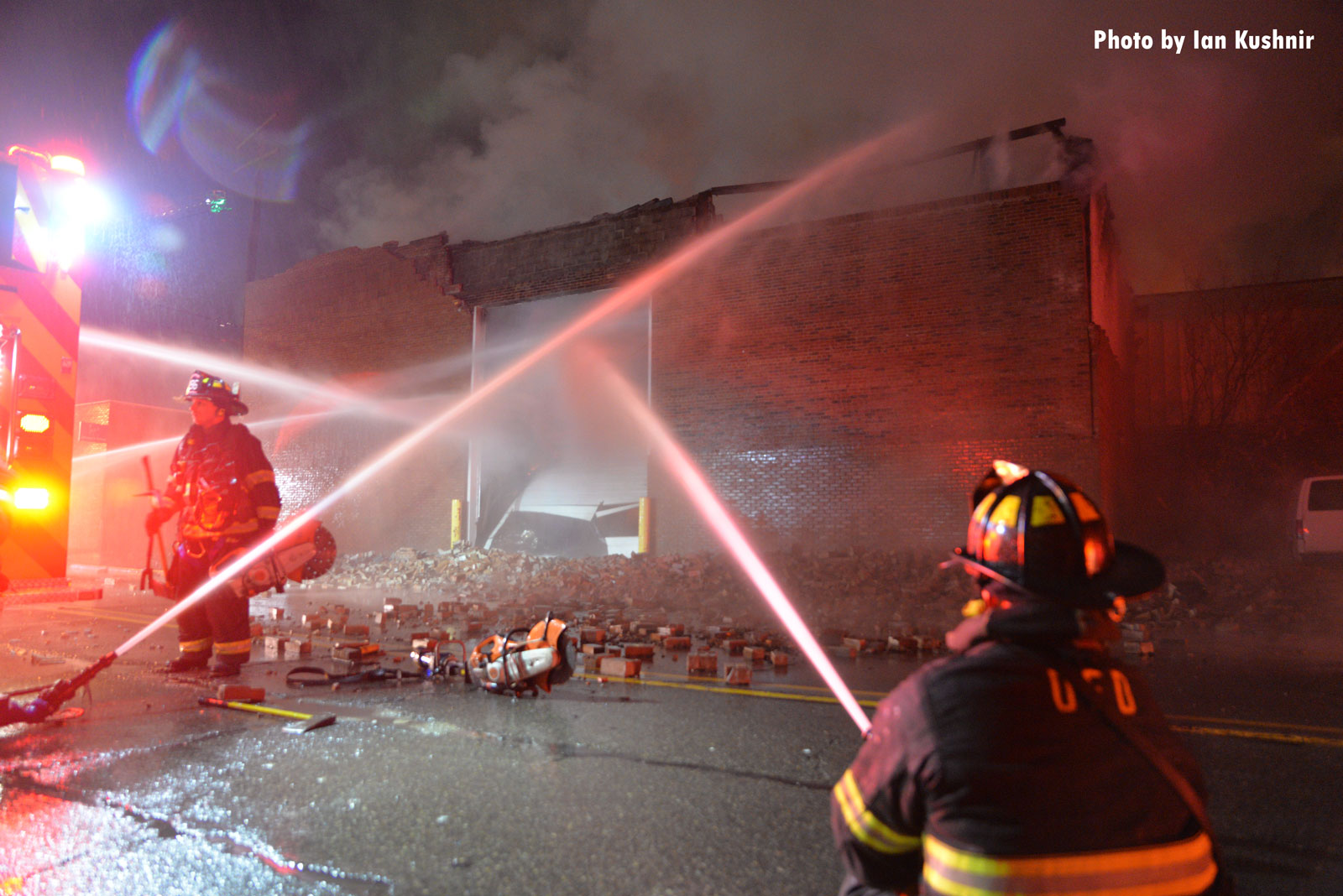 Firefighters apply water to the fire