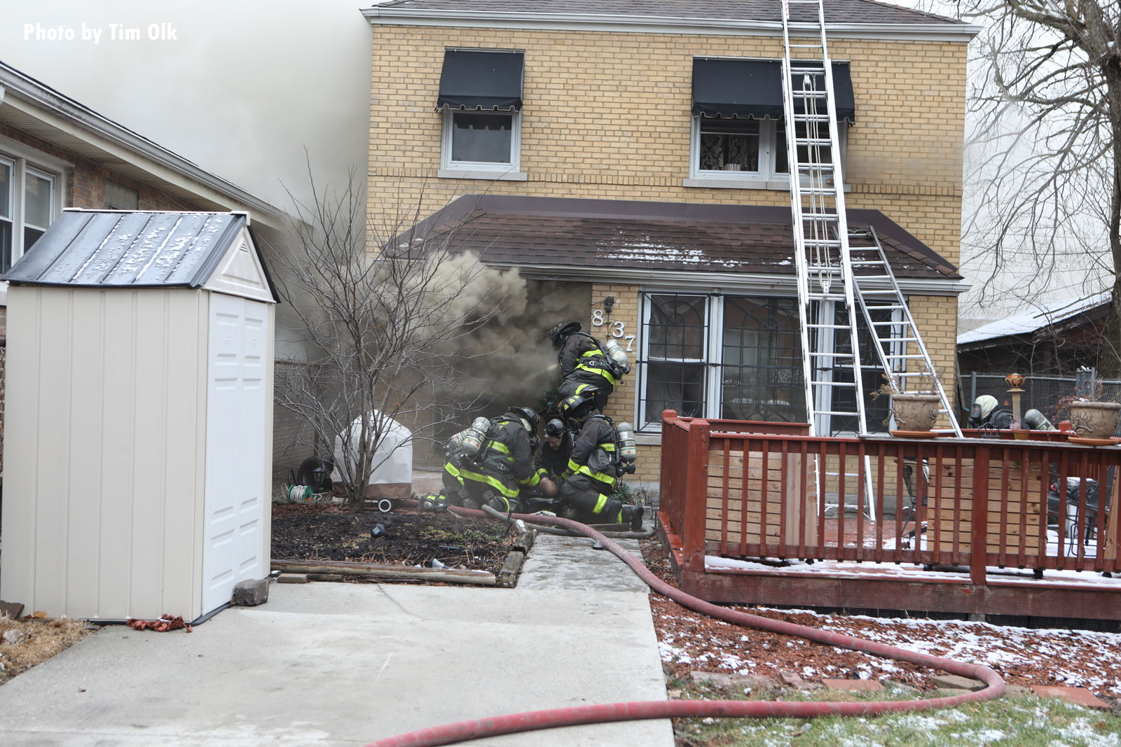 Chicago firefighters work on a down member