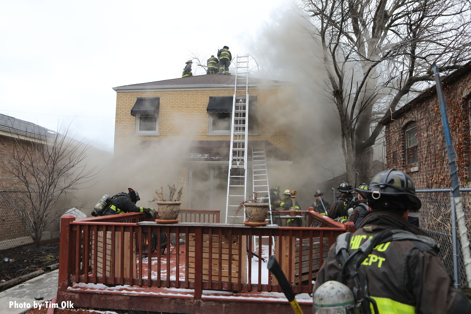 Firefighters work on the roof during the fire