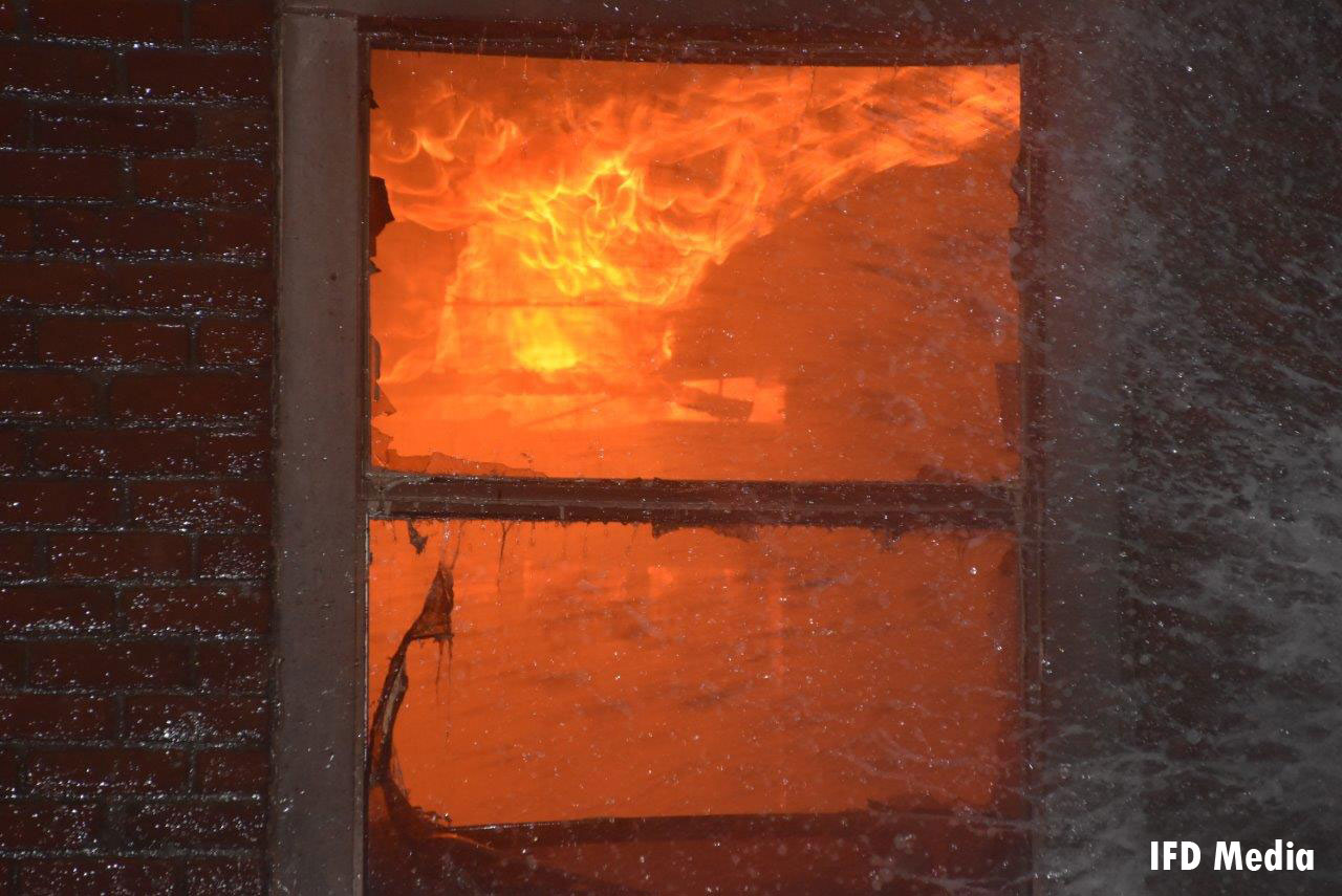 Raging flames seen through a window