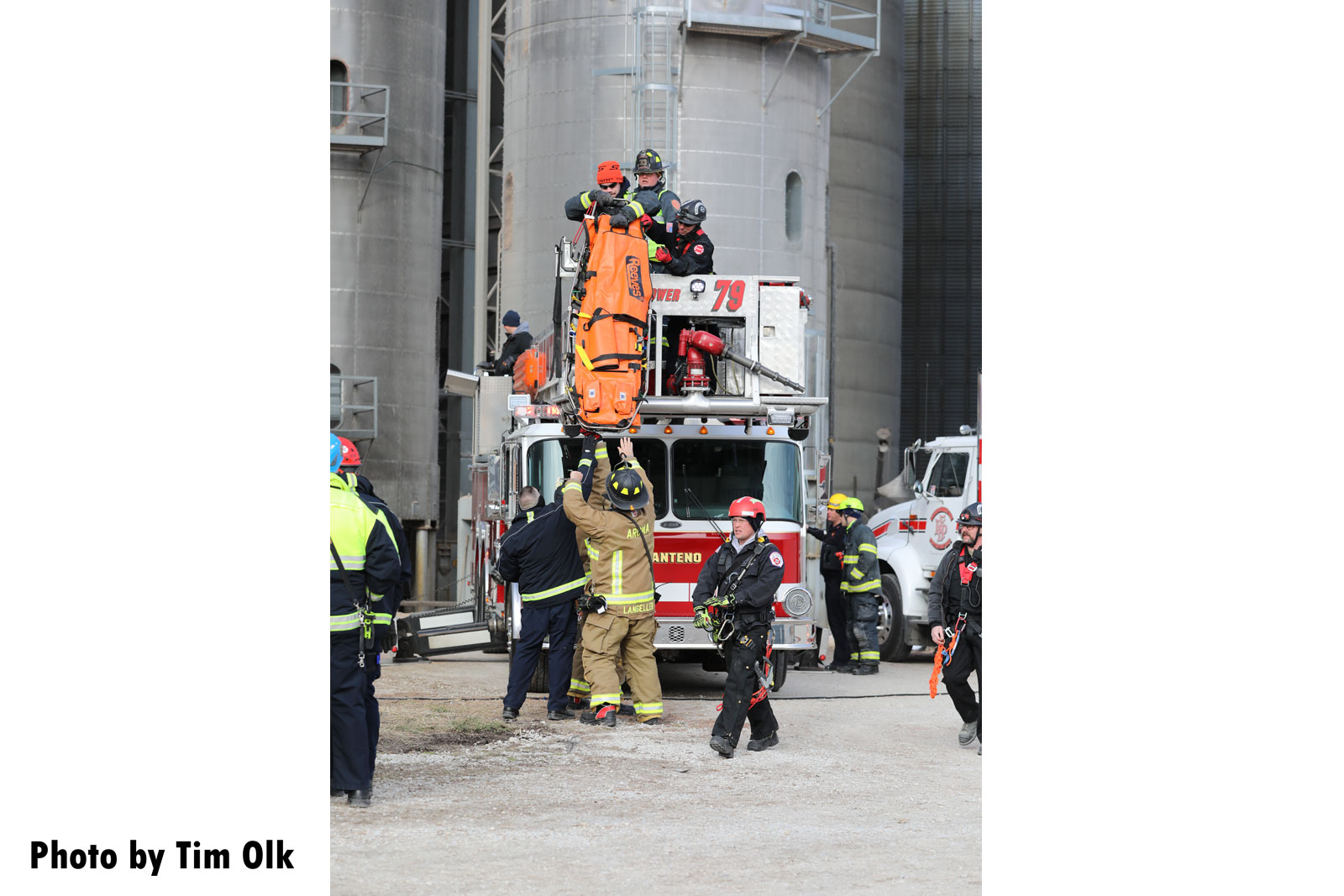 Firefighters respond to the scene of a rescue and recovery operation at a grain bin near Manteno, Illinois.