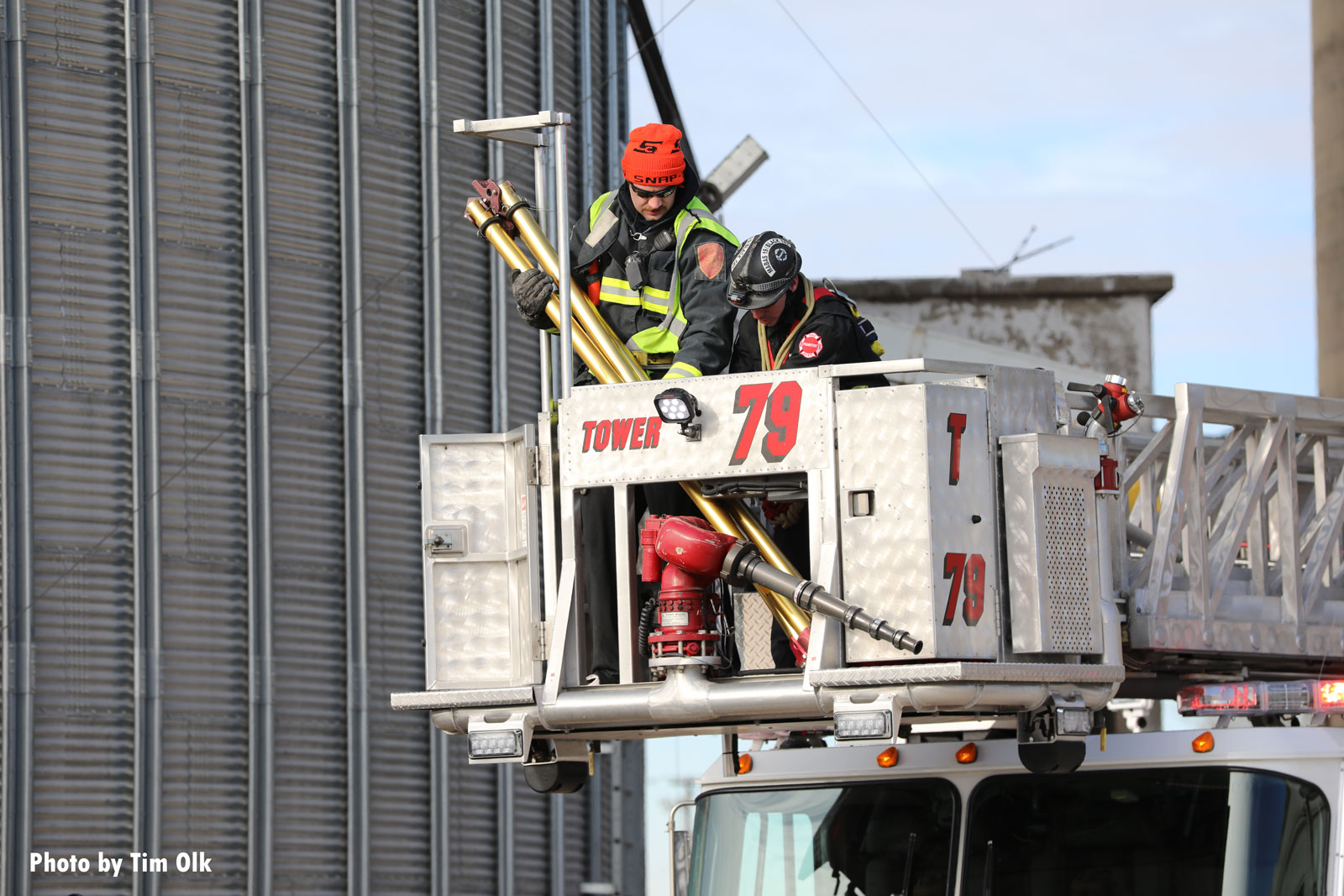 Firefighters in a tower ladder bucket during the rescue operation
